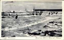Ak Rostock Warnemünde, Strand und Mole bei Sturm aus Nordwest, badende Frauen