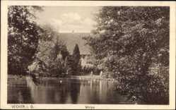 Postcard Vechta in Niedersachsen, Welpe, Blick vom Wasser zum Gebäude