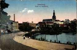 Ak Insterburg in Ostpreußen, Straßenpartie am Schlossteich, Kirche