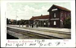 Postcard Cadenberge, Blick auf den Bahnhof, Gleise, Passanten, Fahne