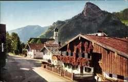 Postcard Oberammergau, Stadtansicht, Glockenturm, Felsmassiv, Blumenkästen