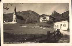 Foto Ak Kreuth am Tegernsee Oberbayern, Dorfpartie, Kirche