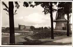 Postcard Emden in Ostfriesland, Partie am Schwanenteich mit Windmühle
