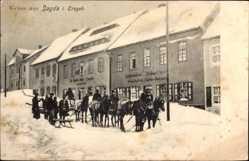 Postcard Sayda im Erzgebirge, Pferdeschlitten, Geschäfte, Straßenpartie, Winter