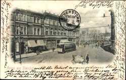 Postcard Staßfurt im Salzlandkreis, Straßenpartie, Straßenbahn, Geschäft Carl Altmann