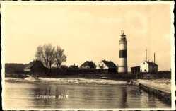 Foto Ak Ostseebad Strande, Blick auf den Leuchtturm Bülk, Häuser, Steg