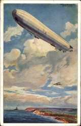 Künstler Ak Schulze, H.R., Ansicht eines Zeppelins über der Küste