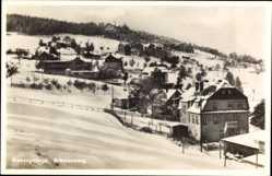 Ak Brückenberg b. Krummhübel Schlesien, Teilansicht, Schnee, Häuser