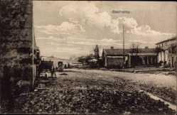 Postcard Bechamp Val d'Oise, Straßenpartie im Ort, Bauerngehöfte