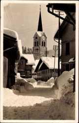 Postcard Oberstaufen Allgäu, Winteraufnahme, Stadtansicht, Glockenturm