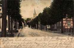 Postcard Voerde am Niederrhein, Blick in die Lindenstraße mit Blick zur Kirche