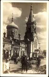 Foto Ak Melitopol Ukraine, Ansicht der Kirche, Vorplatz, Geschäft, Pferdekarren