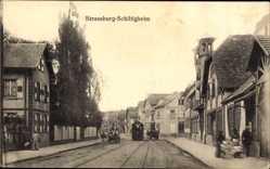 Postcard Straßburg Schiltigheim Elsaß Bas Rhin, Straßenbahn, Straßenpartie, Häuser