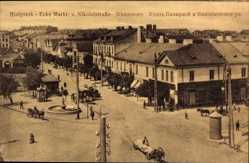 Ak Białystok Ostpreußen, Ecke Markt und Nikolaistraße, Fuhrwerk, Brunnen