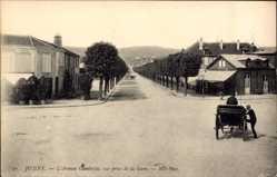 Ak Joigny sur Meuse Yonne, L'Avenue Gambetta, vue prise de la Gare, Hotel, Cafe