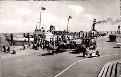 Postcard Norderney in Ostfriesland, Partie am Hafen, Dampfschiff Frisia IV