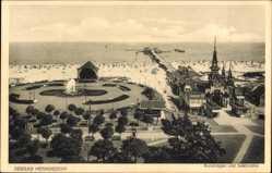 Postcard Ostseebad Heringsdorf auf Usedom, Kuranlagen und Seebrücke, Strand