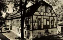 Postcard Warmbad Wolkenstein im Erzgebirge, Blick auf ein Fachwerkhaus