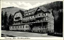 Ak Ilsenburg am Nordharz, Straßenpartie mit Blick auf ein Fachwerkhaus