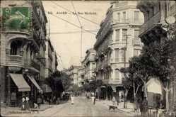 Postcard Algier Alger Algerien, La Rue Michelet, Straßenpartie mit Geschäften
