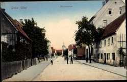 Postcard Gröba Riesa an der Elbe, Blick in die Kirchstraße, Anwohner