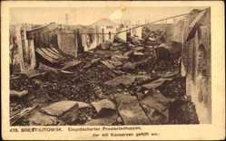 Postcard Brest Litowsk Weißrussland, Eingeäscherter Priviantschuppen mit Konserven