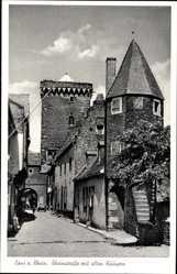 Postcard Zons am Rhein, Blick in die Rheinstraße mit alten Häusern, Turm, Torbogen