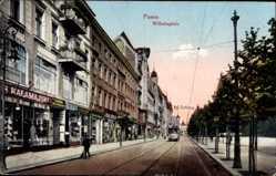 Ak Poznań Posen, Wilhelmplatz, Straßenbahn, Geschäfte, Kalamajski