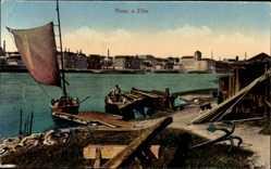 Ansichtskarte / Postkarte Riesa an der Elbe Sachsen, Flusspartie, Anker, Fischerboot, Blick auf den Ort