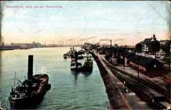Postcard Mannheim, Blick von der Rheinsbrücke, Kai, Boote, Häuser, Schornsteine