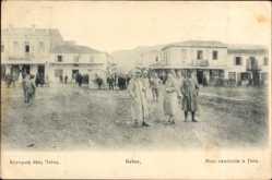 Postcard Itea Griechenland, Rue centrale, Straßenpartie im Ort, Passanten, Hotel Delfi